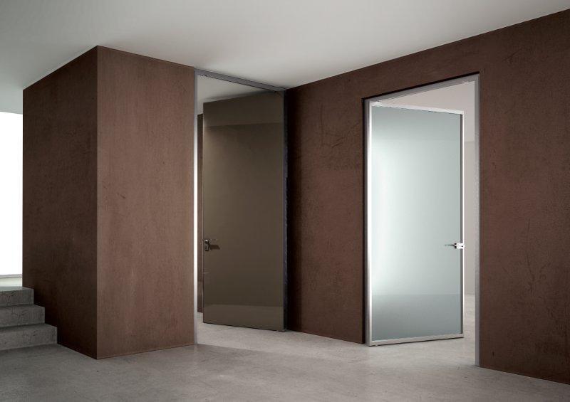 Porte adielle design e movimenti lineari oltre le porte - Porte interne a filo muro ...