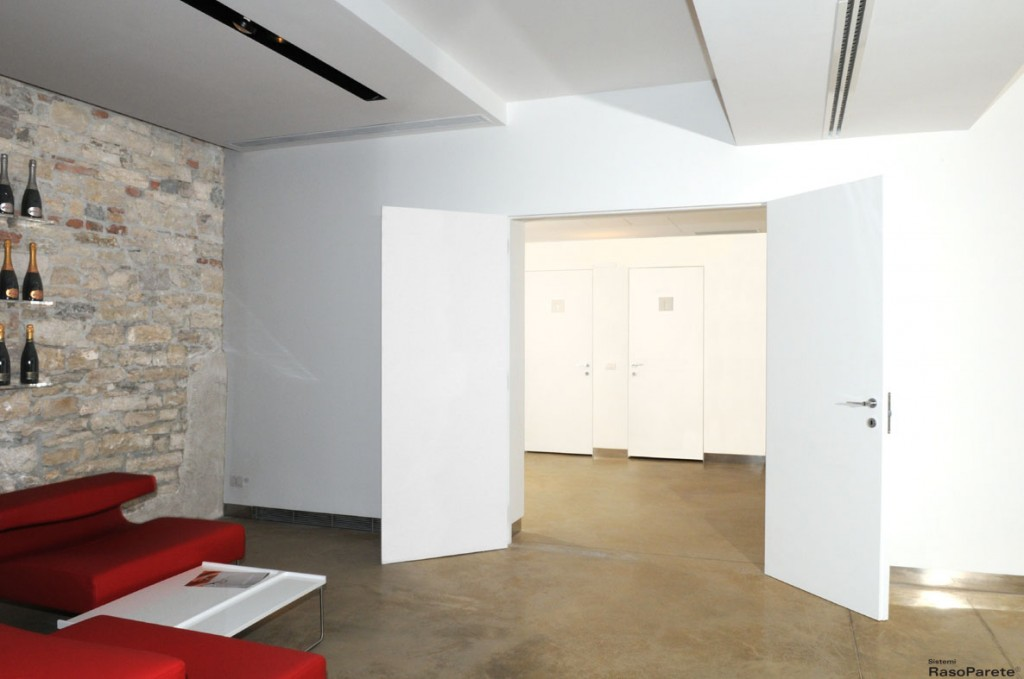 Sistemi raso parete e le porte a scomparsa oltre le porte - Porte invisibili scorrevoli ...
